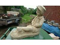 Boy sitting garden ornament