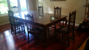 Large antique dining table and chairs