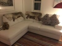 Nearly new white leather corner sofa for sale in excellent condition.
