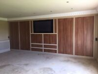 Huge fitted wardrobes! Lovely real wood and the TV!