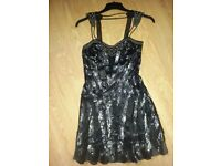 black sequin dress and matching shoes