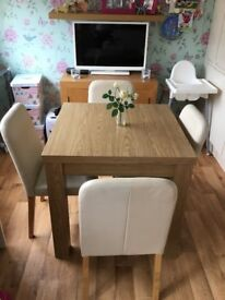 Next Oak Extendable Table with 4 Cream Leather look chairs