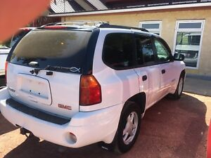 2004 GMC envoy it's white in colour