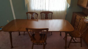 Maple dining room table and 4 chairs.