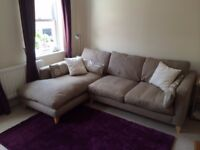 DFS corner sofa with matching footstall.