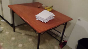 Wooden table on metal frame