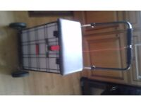 VIRTUALLY NEW SHOPPING SUPPORT TROLLEY USED ONE TIME ONLY VERY SOLID WITH 4 WHEELS AND A SEAT