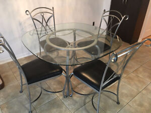 Glass breakfast table set with 4 chairs