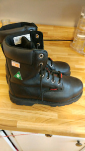 Steel toe boots, worn once indoors with metatarsal protection.