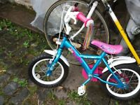 Child's bicycle. As new. 14 wheel size. Suit 3-5 yr old. Apollo PomPom.Blue and pink.