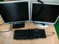2 computer monitors and a keyboard.