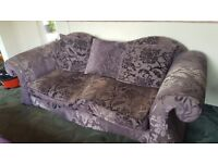 2 purple sofas
