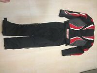 Women's motorbike clothes. Jacket, trousers, gloves.