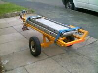 towing dolly, new tyres, new winch, new straps, ramps hand made but good., can deliver for a fee.