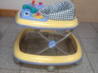 Baby walker in xcellent condition-has removable toy console ,thick padded seat