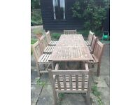 Teak garden table and 8 chairs. seats 8-10