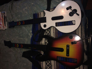 2 Guitar hero/Rock Band guitars and 3 games for Wii