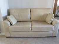 Collins and Hayes cream leather sofa and matching footstool