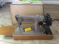 Hand Operated Singer Sewing Machine Model 201 with case.