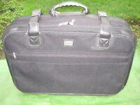 Large-Medium Black Saxoline Suitcase with Wheels