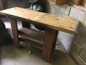 Wooden  workbench on roller wheels