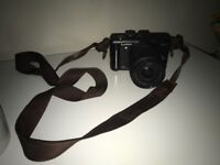 Panasonic DMC-GF1 camera good condition comes with a g Varro lens and leather strap