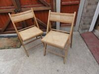 2 Wooden folding dining chairs - rattan base/back. Easily stored but stylish enough for guests use.