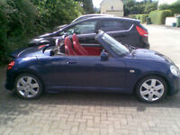 Daihatsu Copen Roadster Convertible 2-seater. Electric hard top. Blue with red leather interior.