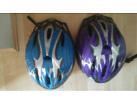 An adult cycling helmet for sale (purple)