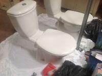 Toiletpan, heated towel rail and washbasin and taps