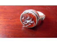 LARGE SOLID SILVER BYZANTINE RING WITH RED CARNELIAN INTAGLIO. CIRCA 1800'S