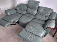 Electric reclining olive green sofa