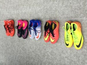5 Pairs of youth soccer shoes ranging in price from $10 to $ 45