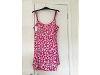 Brand new with tags Magisculpt swim dress from SimplyBe. Pinks & white, size 22