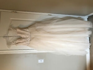 Unaltered/never worn wedding dress