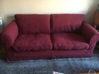 Three seater sofa and armchair plus footstool