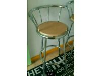 Pair of bar stools with steel frame and wood base
