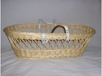 Moses basket, light coloured wicker, with carrying handles and good quality mattress.