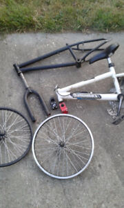 two bmx frames and other bike parts