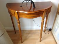 Half Moon Table in lovely condition . Lots of character with a small opening drawer.
