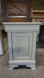 Small, cream painted bedside table with drawer and cupboard