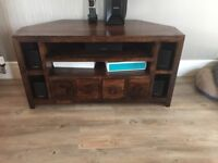 Solid wood corner table. Good conditions. Smoke free home. It has 6 small drawers