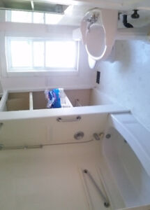 Tub, pedestal sink, and toilet for sale.
