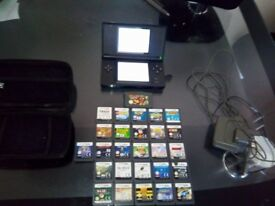Black nintendo ds lite with 26 games