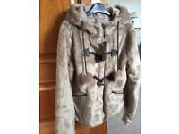 Faux fur jacket size 10. New.