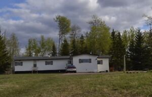 Mobile home on 10 acres