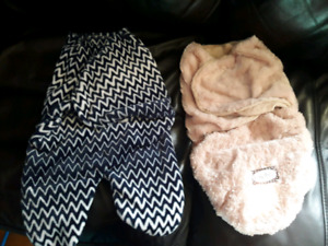 Two baby swaddle blankets