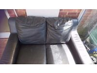*** Free *** solid black leather 2 seater sofa