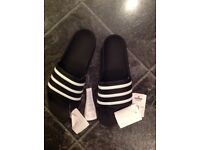 Boxed - Brand New Adidas Originals - black and white flip flops size 11.