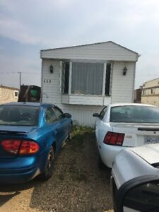 Mobile home on rented lot.